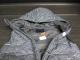Manteau sans manche imparfait
